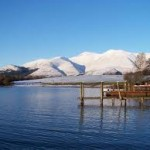 Derwentwater with snow on fells behind